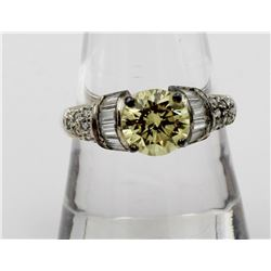 ESTATE STERLING SILVER RING WITH YELLOW STONE AND