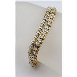 TWO STERLING SILVER GOLD TONED BRACELETS