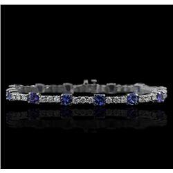14KT White Gold 6.48 ctw Tanzanite and Diamond Tennis Bracelet