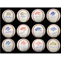 Lot of (12) Signed World Series Logo Baseballs with Cal Ripken Jr., Ozzie Smith, Wade Boggs, Tony La