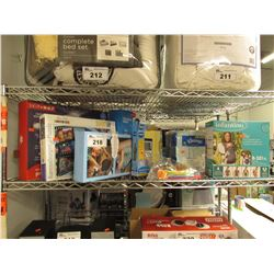 SHELF LOT OF ASSORTED TOYS: PUZZLES, VETCH LEARNING PHONE, SKIP HOP PROJECTION MOBILE & MORE