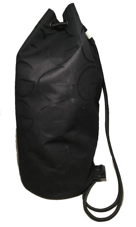 4edaab4b6e28 ... Image 3 : RARE Gucci Black Canvas Sling Backpack Bag ...