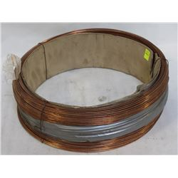 OPEN ROLL OF LINCOLN ELECTRIC COILED WELDING WIRE