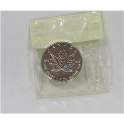 CANADIAN 5 DOLLAR SILVER COIN.