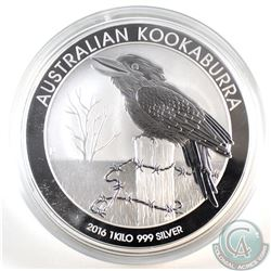 2016 Australia 1 Kilo Kookaburra Fine Silver Coin (Tax Exempt). Capsule contains light scratches.