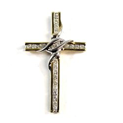 Cross pendant fashioned in 14-karat Yellow Gold with Rhodium plated settings 3.1g, contains 24x .02