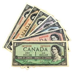 Run of Seven Different Denominations of 1954 Modified Portrait Banknotes. Included is a $1, $2, $5,