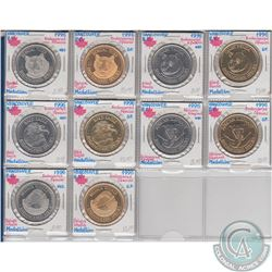 Lot of 10x 1996 Vancouver, B.C. Nickel and Gold Plated Endangered Species Medallions in Plastic Page