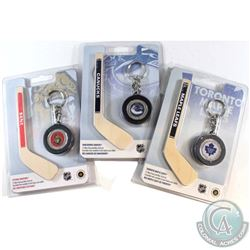 2009 $1 Montreal Canadiens, Ottawa Senators, Toronto Maple Leafs Mini Puck Keychain & Hockey Stick C