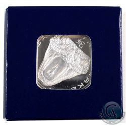 2013 Niue $2 Snake Bite Silver Plated Proof Like Coin. Comes in cardboard shipping box.