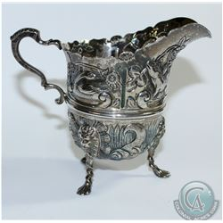 1899 'Chester' - Nathan & Hayes Repousse Sterling Silver Creamer. This elaborate piece contains scen