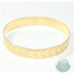 Lady's 10K Yellow Gold Etched Bangle Bracelet. Measures approx. 2 3/4 inches in diameter and weighs