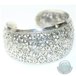 "Vintage Lady's Sterling Silver Pierced Floral Cuff Bracelet. Measures Approx. 2 1/2"" in diameter and"