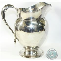 "Graff, Washbourne & Dunn American Sterling Silver Pitcher. Stands 7 1/4"" in Height. Contains some co"