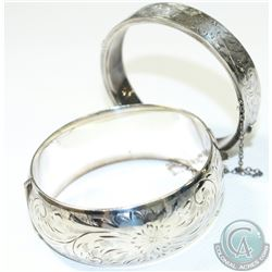 Pair of Antique Birks Sterling Silver Bangle Bracelets with Safety Chain.  Each bracelet contains a