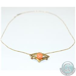 "Lady's 10K Yellow Gold Modernist Pendant/Brooch with Coral Accent on 16"" chain.  4.08 grams."