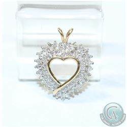 Lady's 10K Yellow/White Gold Diamond Heart Pendant.  This Beautiful pendant has been handcrafted wit