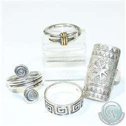 Lot of Tribal Style Sterling Silver Rings.  Rings are 6 1/2 to 9 1/2 in size.  Large Ring is signed