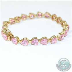 "Lady's 14K Yellow Gold Heart Shaped Pink Tourmaline Bracelet.  Measures 7 1/2"" in length  with a tot"