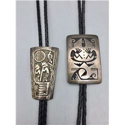 Pair of Sterling Silver Bolos