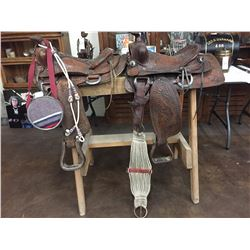 Two Used Saddles and One Canteen