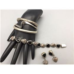 Group of Sterling Silver Bracelets and a Pair of Earrings