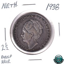 Netherlands 1938 Silver 2 1/2 Gulden deep hair variety. Coin is .720 pure and weighs 25 grams.