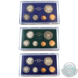 1981, 1982, 1983 Australia 6-coin Proof Sets.  Coins are housed in the mint display slabs with COA's