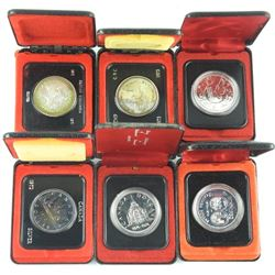 Lot (6) Cased Silver Dollars Mixed.