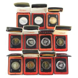 Lot (11) Cased Silver Dollars Mixed