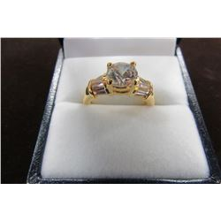 CZ Solitaire ring with side baguettes set in gold plate