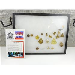 ASSORTED BADGES & PINS IN DISPLAY CASE