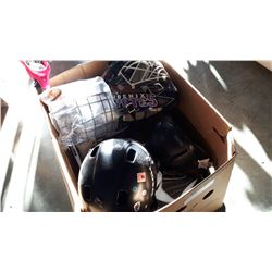 BOX OF HELMETS AND ROLLER SKATES