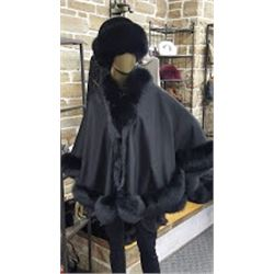 Courtesy of Muscalus Furs a Beautiful Black Cashmere Cape with Fox Trim