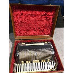 1950's Hohner Accordian in original case polished pearl finish (rare)