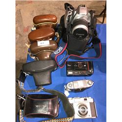 9 Vintage Cameras including Canon, Zeiss, Yashica