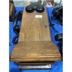 Wall telephone in oak case (great condition)