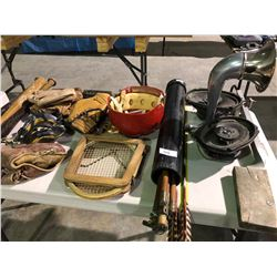 Table of various sports equipment, baseball bats, gloves, Hilltops Football helmet, antique hockey s
