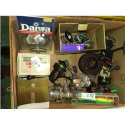 Box full of fishing reels, some unused (great value)