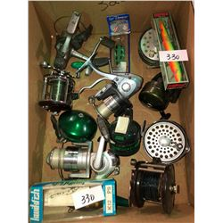 Box full of newer & older reels, fish hooks