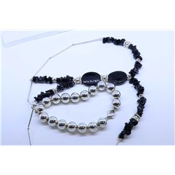 Sterling silver and onyx necklace and a sterling silver beaded bracelet