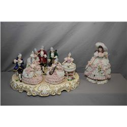 """Two German Dresden figurines including seven figure musical scene 17"""" in length and a 10 1/2"""" lady,"""