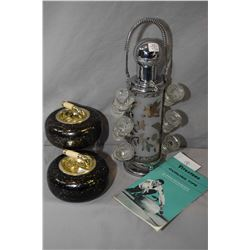 Selection of retro bar items including airplane motif cocktail shaker, frosted glass and chrome pump