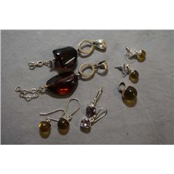 Selection of sterling silver jewellery including two cherry red amber pendants, two pairs of golden