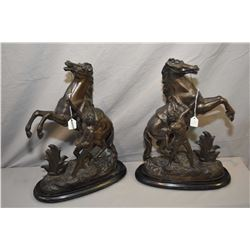 Pair of antique spelter garnitures featuring rearing horse and handlers, each on wooden base, note r