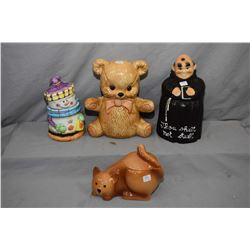 Four character cookie jars including snowman, monk, kitty cat and a teddy bear