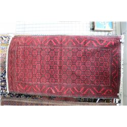 """Persian wool carpet with red background, geometric center panel and border in black and cream, 39"""" X"""