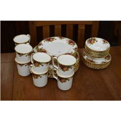 Royal Albert Old Country Roses china dinnerware including eight each of dinner, lunch and bread plat