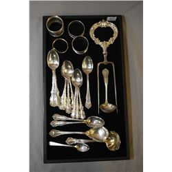 Selection of sterling silver including napkin rings, teaspoons, berry spoons, and large carving fork