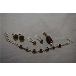 Selection of sterling silver jewellery including golden amber sphere bracelet, earrings and matching